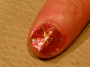 Pointer finger red snowflake design