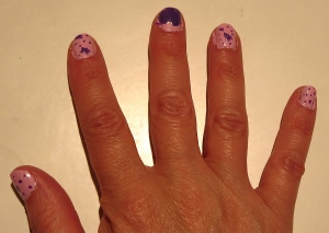 pink and purple paint splatter nail design
