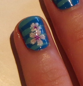 salon blue nail with stripes and stickers