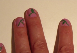 pink leafy vine nail design