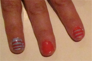 orange and blue stripe nails