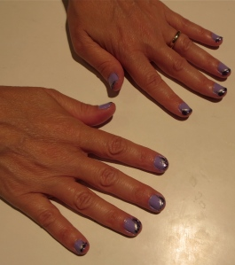 purple nail design with silver and purple sparkle tips