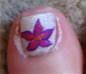 white pedicure with purple flowers