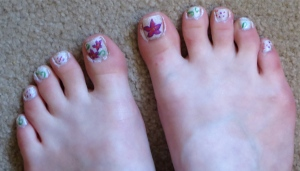 white toenails with purple flowers