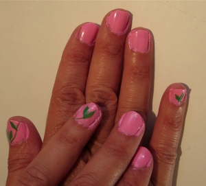 pink nail design with green leaves