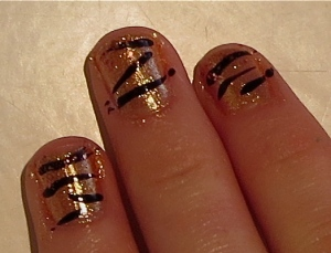 copper sparkly tips tiger stripe nails
