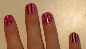 close up pink stripes and dots nails