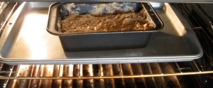 putting apple cinnamon chocolate peanut butter banana bread in the oven