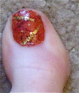 orange and gold pedi big toe
