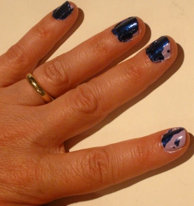 left hand purple/blue paint splatter nail design