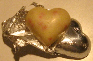 unwrapped white chocolate strawberry heart