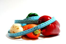 peppers with measuring tape