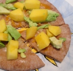 pita pizza with avocado and mango and 4-state cheddar cheese