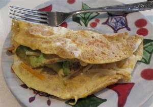 whole wheat savory crèpe with cheddar and avocado