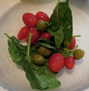 spinach, tomatoes, and olives