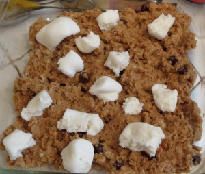marshmallows on peanut butter cookie bars dough