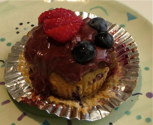 lemon strawberry blueberry cupcake with chocolate yogurt frosting and berries