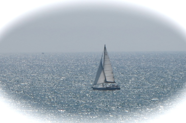 sailboat seen from beach