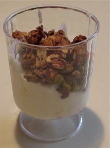 peanut butter chocolate chunk granola with peach pistachio yogurt