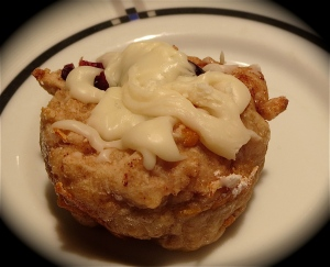 cranberry orange cinn roll white chocolate glaze